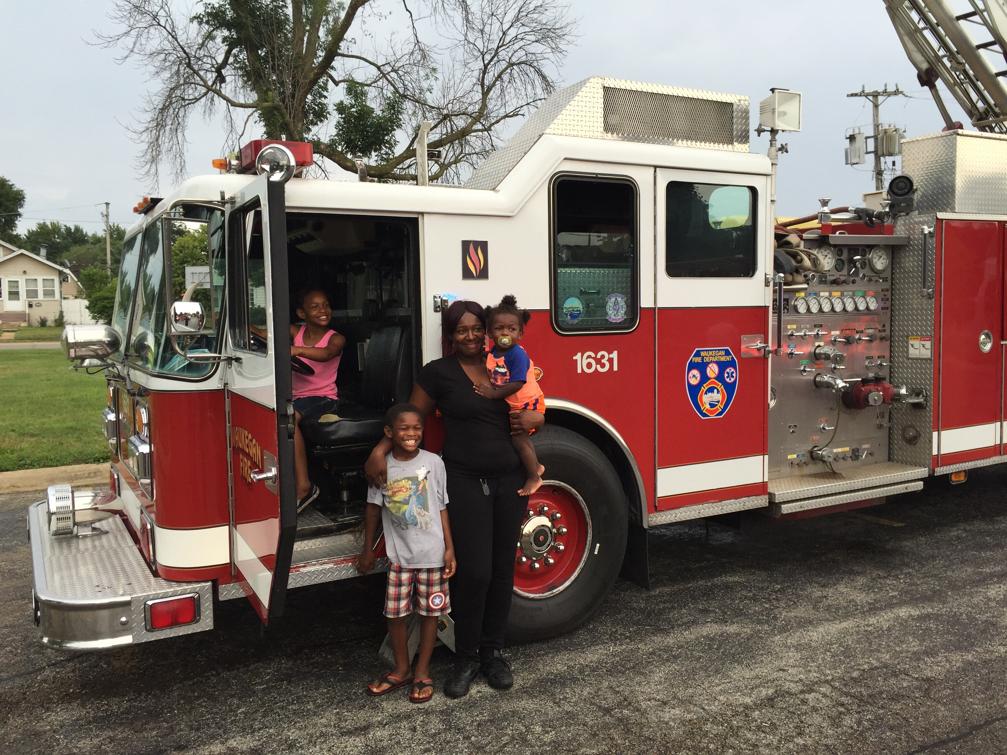 Woman and Children Posing with a Fire Engine